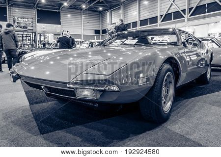 MAASTRICHT NETHERLANDS - JANUARY 14 2016: Sports car De Tomaso Pantera. Black and white. International Exhibition InterClassics & Topmobiel 2016