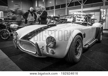 MAASTRICHT NETHERLANDS - JANUARY 14 2016: Sports car Shelby AC Cobra. Black and white. International Exhibition InterClassics & Topmobiel 2016