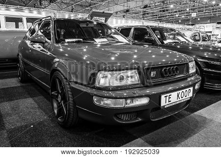 MAASTRICHT NETHERLANDS - JANUARY 14 2016: Compact executive car Audi RS 2 Avant 1989. Black and white. International Exhibition InterClassics & Topmobiel 2016