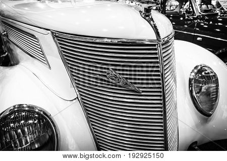 MAASTRICHT NETHERLANDS - JANUARY 14 2016: Full-size car Ford V8 convertible 1937. Black and white. International Exhibition InterClassics & Topmobiel 2016