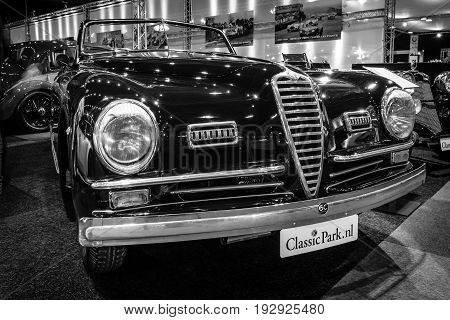 MAASTRICHT NETHERLANDS - JANUARY 14 2016: Sports car Alfa Romeo 6C 2500 SS Pinin Farina Cabriolet 1947. Black white. International Exhibition InterClassics & Topmobiel 2016