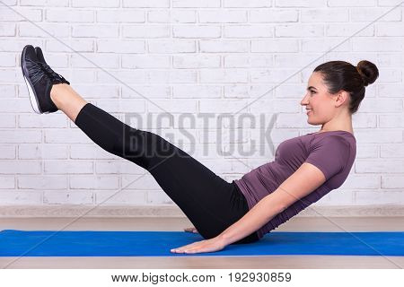 Young Slim Sporty Woman Doing Exercises For Abdominal Muscles