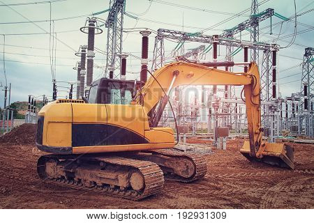 Mechanisms of excavator at  construction site of power station of electricity. Construction industry of industrial equipment