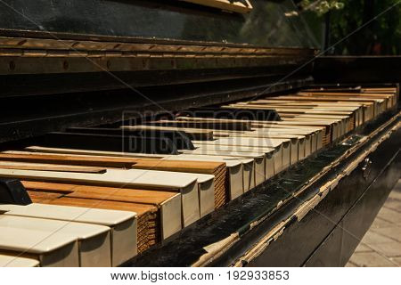 The Old Piano Closeup On The Street.