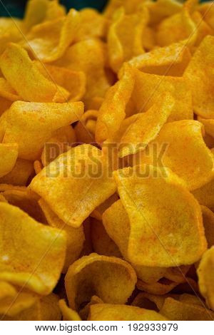 Corn chips close-up background. Abstract food textures.