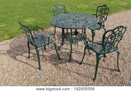 A Metal Set of a Garden Table and Four Chairs.
