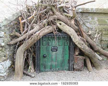A Novelty Beavers Lodge Doorway as a Garden Feature.