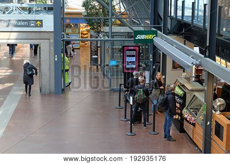 GOTHENBURG SWEDEN - MAY 2017: Fastfood and food stores at the Gothenburg Central Train and Bus Station.