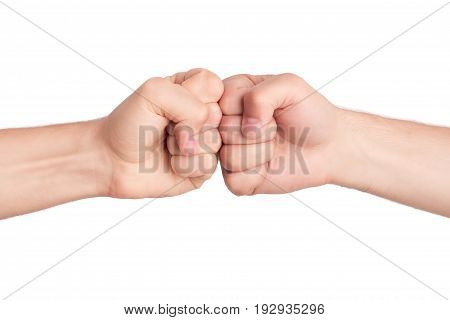 Men hands fist bumping isolated on white background