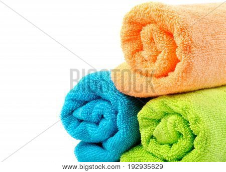 Cotton colorful towels  , closeup, over white background