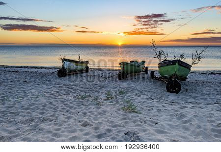 Morning coastal landscape with small fishing boats. Conceptual image symbolizing termination of big industrial fisheries