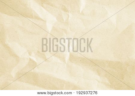 crumpled beige paper background texture,cream color crease backdrop