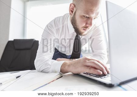 Business young man laptop businessman table computer