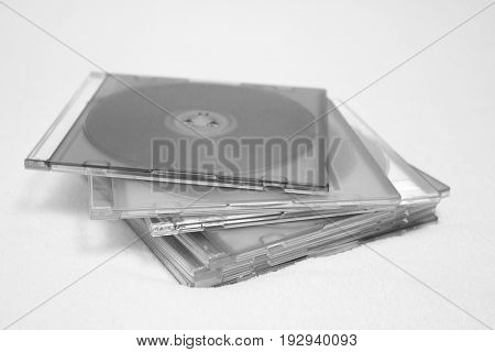 Background of some CD or DVD compact discs. discs in boxes isolated on white background.black and white foto.