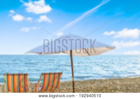 Chairs umbrella chaise longue blue background sky