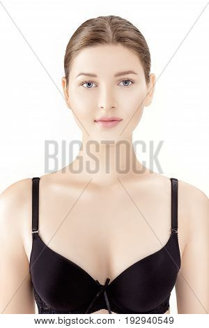 front portrait of young slender woman in black lingerie isolated on the white background