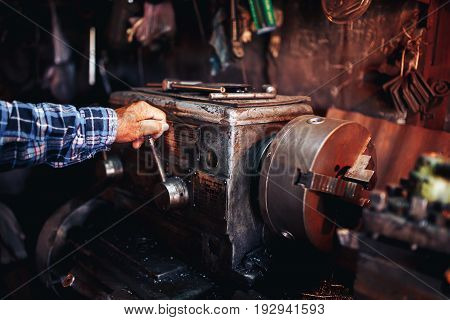 master man in years manages the milling machine the concept of industrial photography the 60th year factories for parts home workshops in the garage.