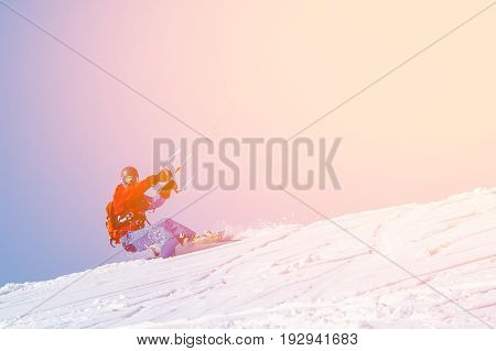 Snowboarder with a kite on fresh snow in the winter in the tundra of Russia against a clear blue sky. Teriberka, Kola Peninsula, Russia. Concept of winter sports snowkite.