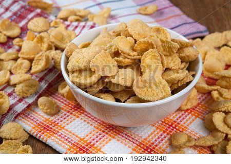 Pile of cornflakes and napkin close up