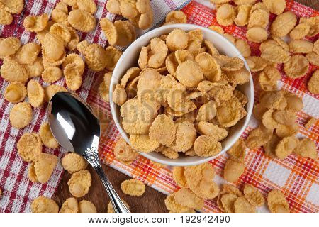 pile of cornflakes and a spoon close up