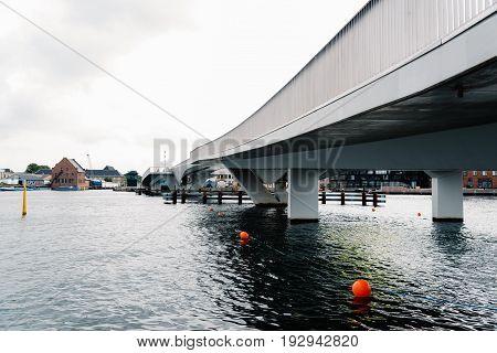 Copenhagen Denmark - August 12 2016: Inderhavnsbroen the Inner Harbour Bridge is a bridge across the Copenhagen inner harbour combined pedestrian and bicyclist bridge a cloudy day of summer.