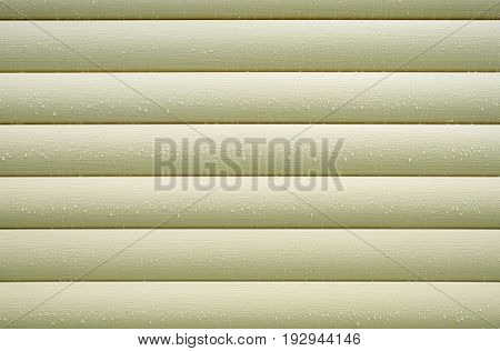 Wall covered with beige siding panels, protect building from bad weather conditions close up horizontal photo as background front view