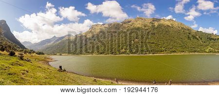 Beautiful lagoon located in Papallacta, the Andean highlands in a sunny day, with the mountains behinds in Quito Ecuador.