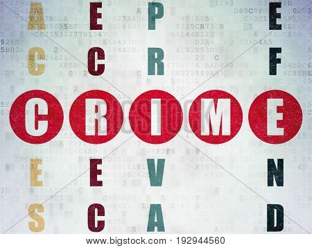 Safety concept: Painted red word Crime in solving Crossword Puzzle on Digital Data Paper background