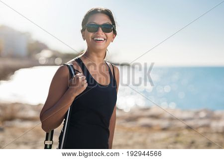 Young Pretty Woman On Beach Laughing