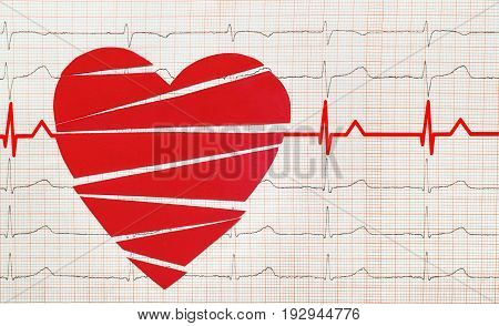 Heart with electrocardiogram test in the background, cardiology concept
