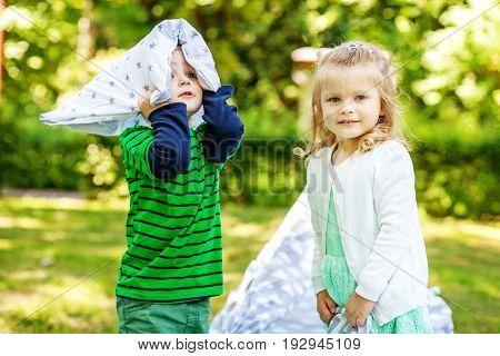 Preschool children play in the park. 2-3 years. Girl and boy. The concept is childhood and family.