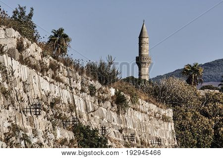 the medieval fortifications and Turkish minaret in Kos in Greece