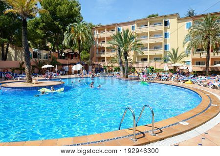 MALLORCA SPAIN - MAY 29: The tourists enjoiying their vacation in luxury hotel on May 29 2015 in Mallorca Spain. Up to 60 mln tourists is expected to visit Spain in year 2015.
