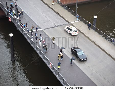 People Crossing Bridge In Hamburg