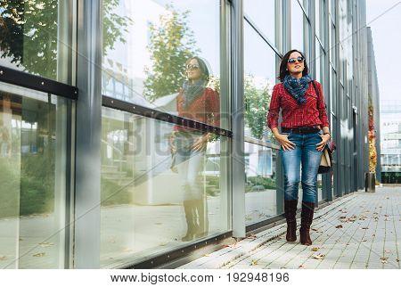 Casual wearing woman walks in autumn city