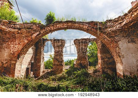 Ruins of an ancient destroyed abandoned Orthodox temple or church of red brick with big Arches in Yeletz, Lipeck region, Russia