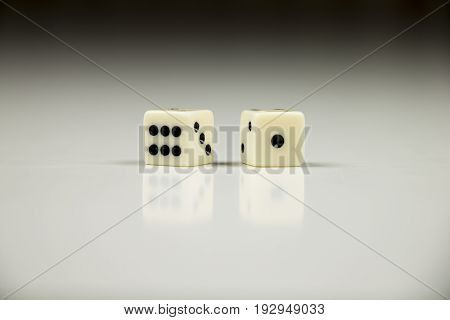 Two dice closeup on black and white background.