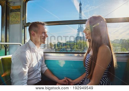 Couple Traveling In Subway Train With View To The Eiffel Tower