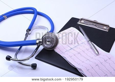 RX prescription, Red heart and a stethoscope isolated on white background.