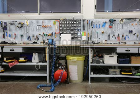 Workbench With Many Tools Inside A Mechanic Workshop Specialized