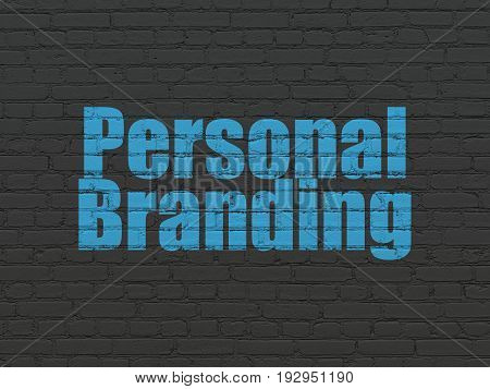 Marketing concept: Painted blue text Personal Branding on Black Brick wall background