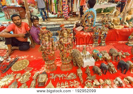 GOA, INDIA - MAR 1, 2017: Market traders selling vintage souvenirs and new artworks by asian jewelers and artisans on March 1, 2017. Near 5 million tourists visit Goa annually