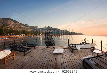 Pier with chaise-longues and umbrellas in the Mediterranean sea, Turkey