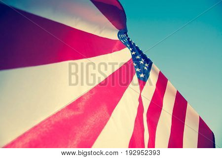 Happy Memorial Day Greeting USA patriotic flag on blue sky and sunlight background with text Happy Memorial Day.