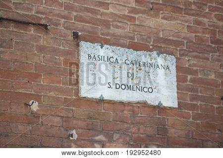 Italy Siena - December 26 2016: the view of the marble sign of Basilica Cateriniana di San Domenico on December 26 2016 in Siena Tuscany Italy.
