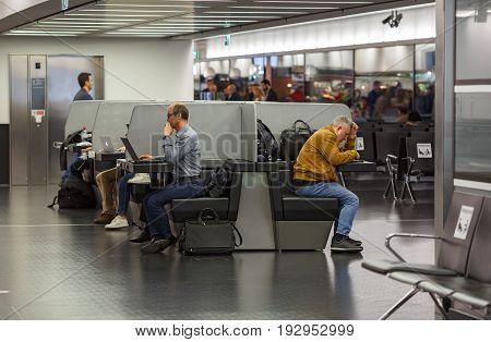 VIENNA/ AUSTRIA - APRIL 6, 2017. People working at laptops in the free Wi-Fi area of the airport Schwechat. Vienna, Austria.