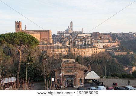 Italy Siena - December 26 2016: the view of the Duomo di Siena from Medici Fortress on December 26 2016 in Siena Tuscany Italy.