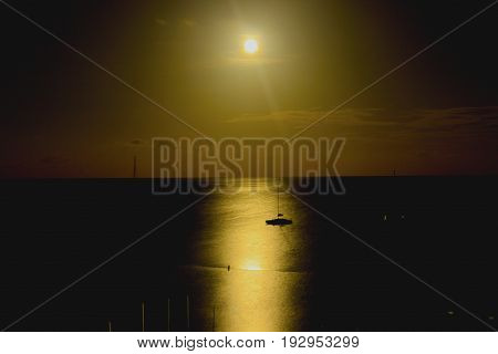 A beautiful summer moon is reflected in the warm waters of the Caribbean
