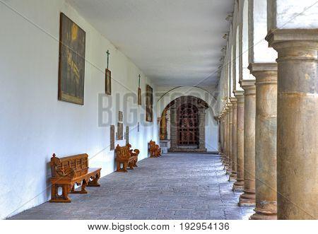 Corridors, columns and benches of the interior patios of the San Francisco church, in Quito, Ecuador