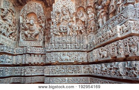 Ganesha Shiva Vishnu lords on relief of great Indian temple. Architecture of ancient temples of Halebidu with carved walls made in 12th century. Hoysaleshwara temple, India